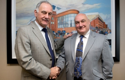 Mr Traynor in happier times with a man now being airbrushed from Ibrox history